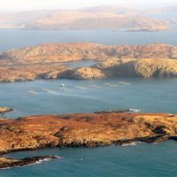 Aerial view of Hellisay salmon farm, Isle of Barra